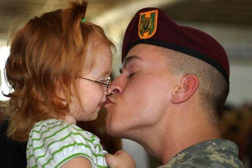 Kissing_his_daughter